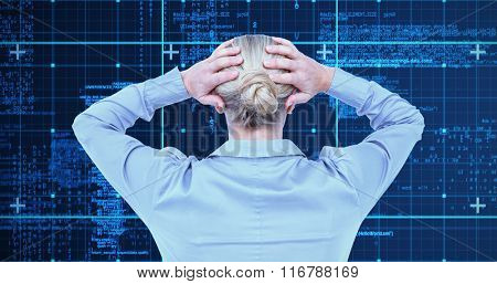 Rear view of worried businesswoman holding her head against blue data