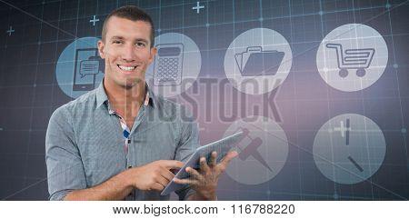 Smiling businessman using tablet computer over white background against blue matrix