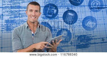 Smiling businessman using tablet computer over white background against blue matrix and codes