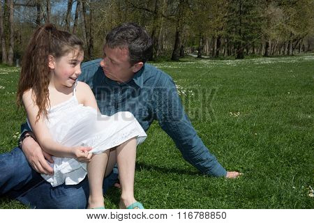 Happy Father And Daughter Talking In Spring Park
