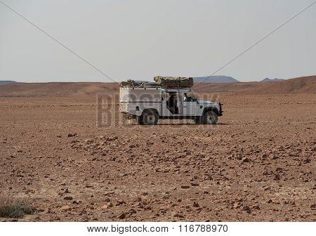 Land Rover in stone desert