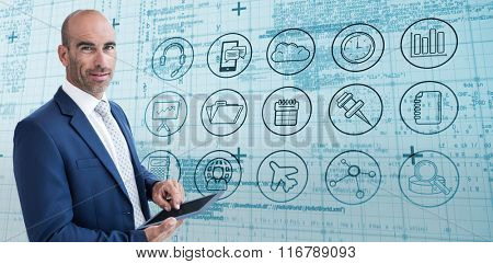 businessman using a tablet and smiling at the camera against blue matrix and codes