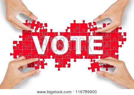Hands Arrange Puzzle With Vote Text