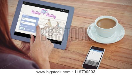 Online dating app against over shoulder view of hipster woman using tablet