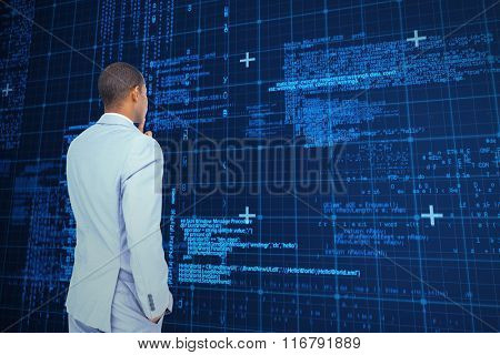 Thinking businessman against blue matrix and codes