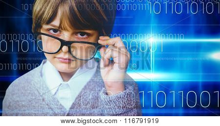 Cute pupil pretending to be teacher against blue technology design with binary code
