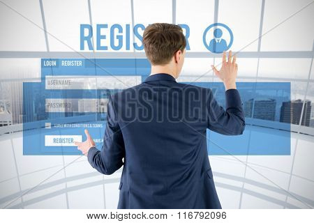 Wear view of businessman showing his hand against modern room overlooking city