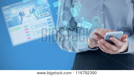 Businesswoman using smart phone against blue background