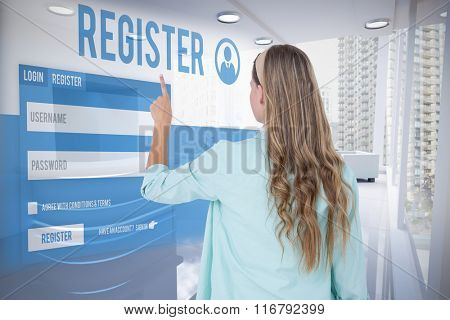 Hipster pointing with her finger against modern room overlooking city