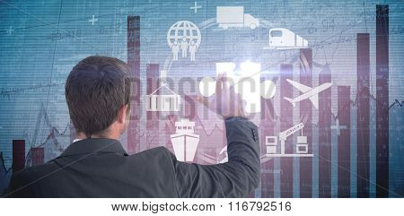 Businessman pointing with his fingers against blue data