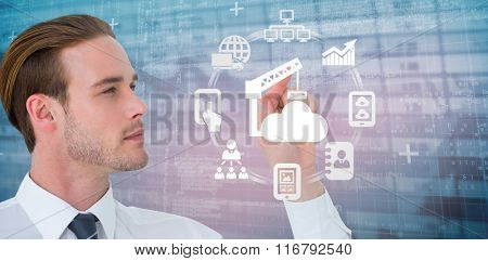 Concentrated businessman pointing with his finger against blue data