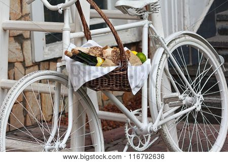 Old Bicycle And Wicker Fruit Basket. Decoration