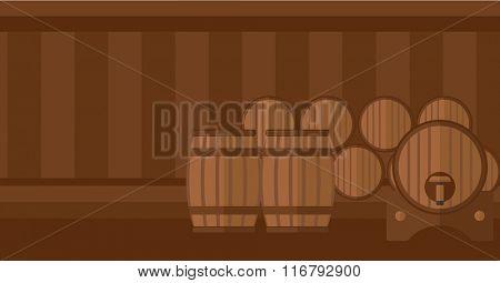 Background of wine barrels in cellar.