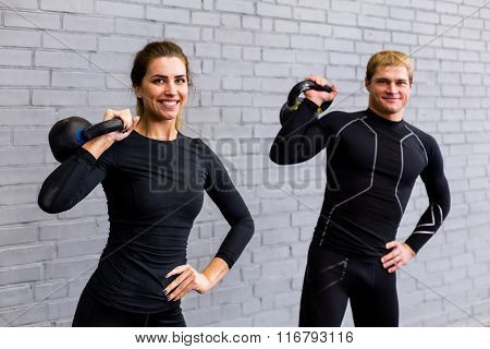 Man and girl in fitness gym