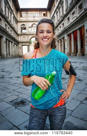 Young Smiling Sporty Woman With Bottle Of Water. Florence