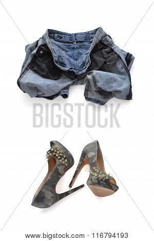 Erasing blue jeans for women. Turned inside out and camouflage high-heeled shoes with spikes.