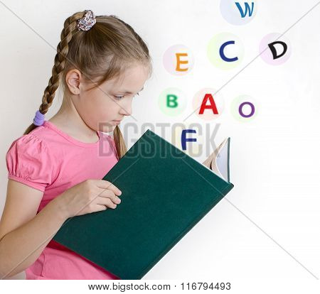 Girl In A Pink T-shirt Reading A Book
