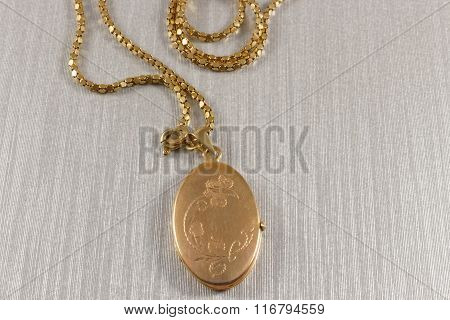 Golden antique locket