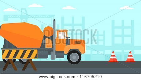 Background of concrete mixer on construction site.