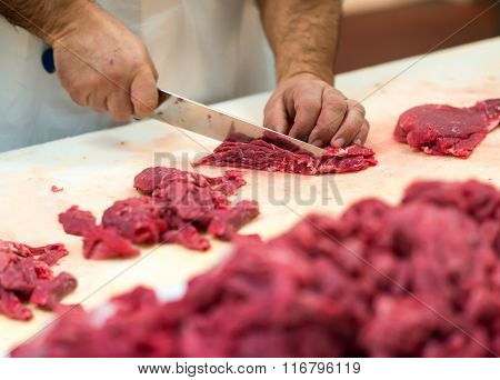 Hands Preparing Cuts Of Raw Meat
