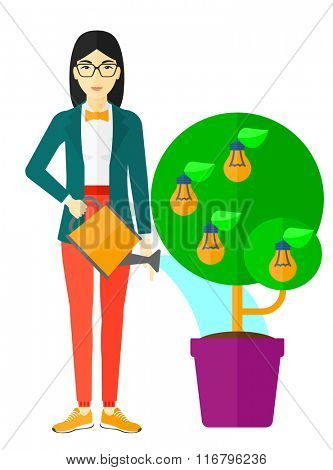 Woman watering tree with light bulbs.