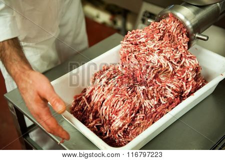 Tray Full Of Minced Meat Next To Machine