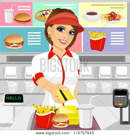 female fast food restaurant employee returning a credit card