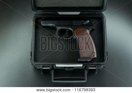 gun in the suitcase