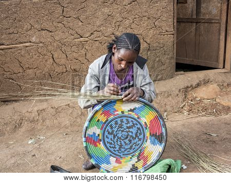 OROMIA, ETHIOPIA-NOVEMBER 5, 2014: An unidentified woman makes a traditional basket in the highlands of Ethiopia