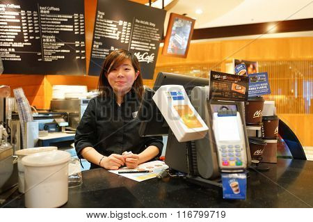 HONG KONG - JANUARY 27, 2016: portrait of McCafe's barista. McCafe is a coffee-house-style food and drink chain, owned by McDonald's.