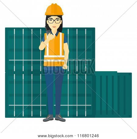 Stevedore standing on cargo containers background.