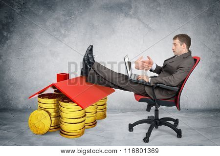 Businessman giving hand to laptop