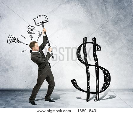 Businessman with hammer and dollar sign