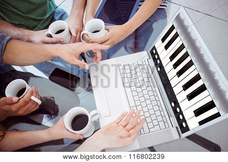 Music app against fashion students holding cup of coffee