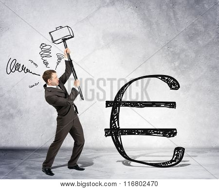Businessman with hammer and euro sign