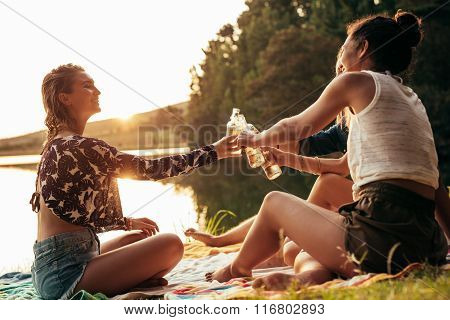 Young Women Celebrating At A Lake