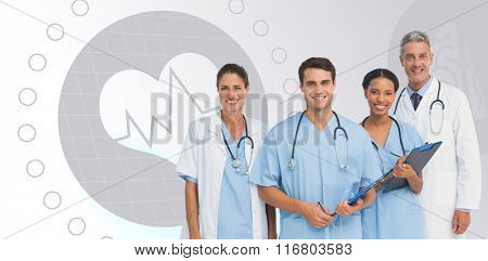 Portrait of confident medical team against light grey
