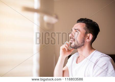 Nice Beardy Man Having Phone Conversation In His Bedroom