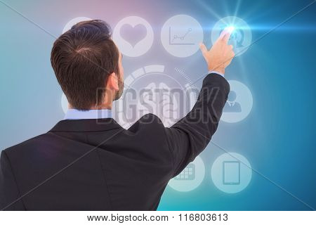 Businessman in suit pointing these fingers against blue background