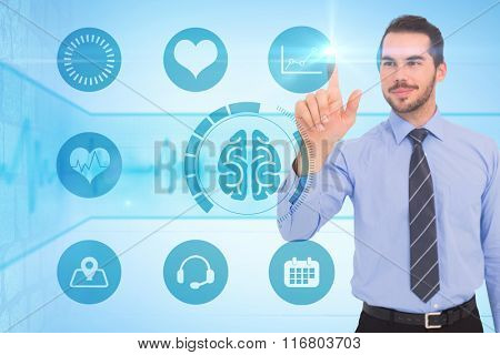 Happy businessman standing and pointing up against medical background with blue ecg line