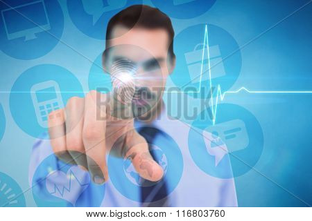 Businessman pointing his finger at camera against electrocardiogram