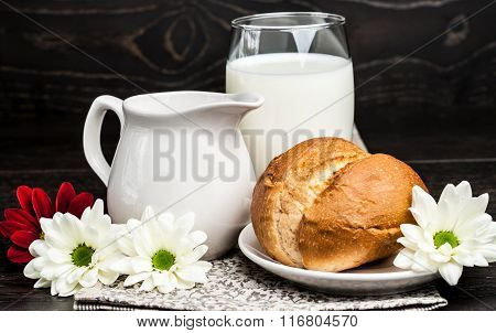 Glass Of Milk And Fresh Rolls On The Table
