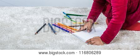 Child Hands Drawing With Pencil