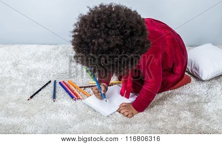 Curly african girl drawing with pencils