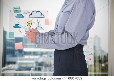 Businesswoman using her tablet against adhesive notes on window