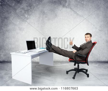 Businessman sitting on chair with table laptop