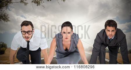 Business people ready to start race against road landscape