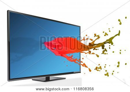 Flat screen television against pink paint splashes and drops