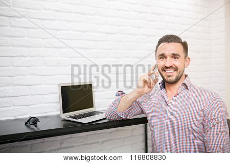Smiling Man During Morning Phone Call