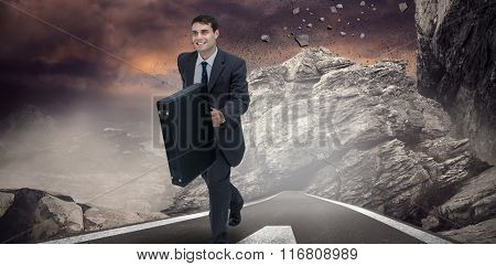 Smiling businessman in a hurry against dark road landscape
